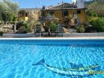 Stunning large heated pool. Superb dining/pergola overlooking the pool