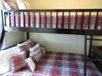 Single of double bunk beds are upstairs.