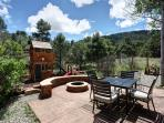 Backyard with hot tub, table/chairs, fire pit and playset