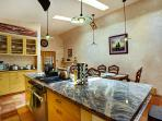 Fully stocked kitchen with Keurig coffee maker and coffee/creamer, crockpot, spices & much more