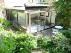 Conservatory opening onto private terrace