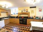 Superbly equipped large kitchen with additional seating