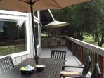 Front deck with two tables, golf balls.....