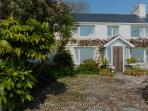 Glen Chass Farmhouse overlooks breathtaking land and sea views in the beautiful south of the Island.