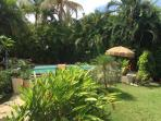 view of tropical garden, patios and pool