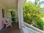 Enjoy the privacy & foliage on this porch