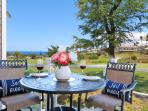 Lanai dining table with gorgeous ocean views.