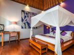 Purple bedroom with LCD TV