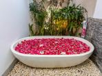 Bathtub with rose petal