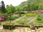 The terrace overlooking the flower section of the walled garden - a good place for an evening drink