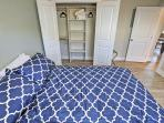 Rest your head on this cozy Queen-sized bed for a restful nights sleep.