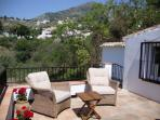 Second terrace with seating and views towards Mijas village