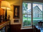View from dining room to 1872 stone church