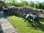 Garden to ear of cottage gets evening sun for the perfect setting to your evening BBQ and/or drinks