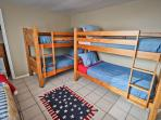 Lower level bedroom with two Twin beds and two Twin bunk beds