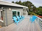 Upper level ocean facing deck with patio chairs