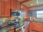 This beautiful kitchen comes fully equipped with modern appliances.