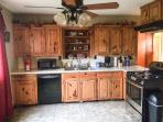 Kitchen which is fully stocked w/pots and pans, serve ware and glassware