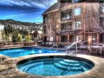 Dakota Lodge Pool and Hot tubs - The year round outdoor heated pool and hot tubs are located right outside of this...