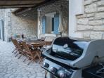 Weber barbecue and shaded dining area