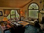 1st of 3 Living Rooms, this one with Reclining Sofas, Fireplace, & HDTV system.