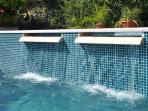 The water flows from jacuzzi to the pool through waterfall, very pleasant to listen to in summer