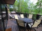 Huge back deck with a Fire Pit table, 7 person Hot Tub, Hanging Day Bed (my favorite nap place)!