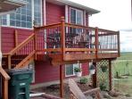 Front deck, Table with 4 chairs, 2 extra chairs, New stainless steel BBQ grill for use.