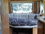 Front double bed with raskelf mattress. Can be changed to seating for upto 8.