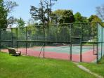 Tennis court that doubles as a basketball and street hockey cour