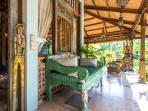 Villa: Carved day bed on the side veranda.