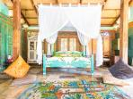 Villa:  Carved teak bed, Egyptian woven rug, carved walls and pillars, marble floor.