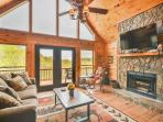 Great room with wood burning fireplace, plenty of seating and views!