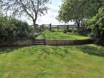 The back garden, with gate through to three acres of paddocks.  Enjoy!