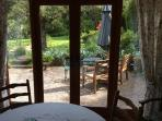 Looking out into the garden through the new patio doors while having dinner.
