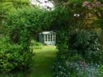 Honeysuckle Archway to the garden summerhouse