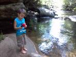 Little boys love to fish; a mile hike from cabin is Sawyer Brook