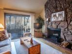 Relax by the wood burning fireplace in this cozy living room with flat screen TV/DVD, family games and patio access.