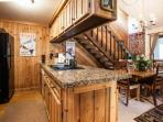 The remodeled kitchen with granite countertops and all the essentials to dine in or entertain.