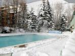 Evergreen's all season heated pool surrounded by fresh powder.