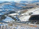 a winter view from the hills directly above the house