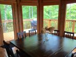 Dining room table and view. Bar-b-q Grill right close to the kitchen and dining room table