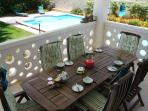Verandah with pool, garden and sea views. Perfect for al fresco dining, complete with gas BBQ