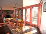 French doors to deck, with charcoal grill, picnic table and more.