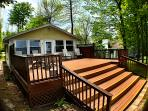 A huge front deck and stairs for your use with seating and gas grill.