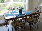 Dining area with Iron Chairs and upholstered  seats