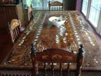kitchen table imported from India hand carved inlay huge and what a view of the lake!