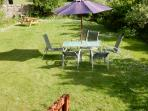 ALFRESCO DINING, CHATTING, RELAXING, AND PLAYING  IN THE GARDEN