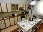 Equipped Kitchen and Dining Table