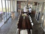 The dining room glass doors fold back giving access to both front and back decks for entertaining